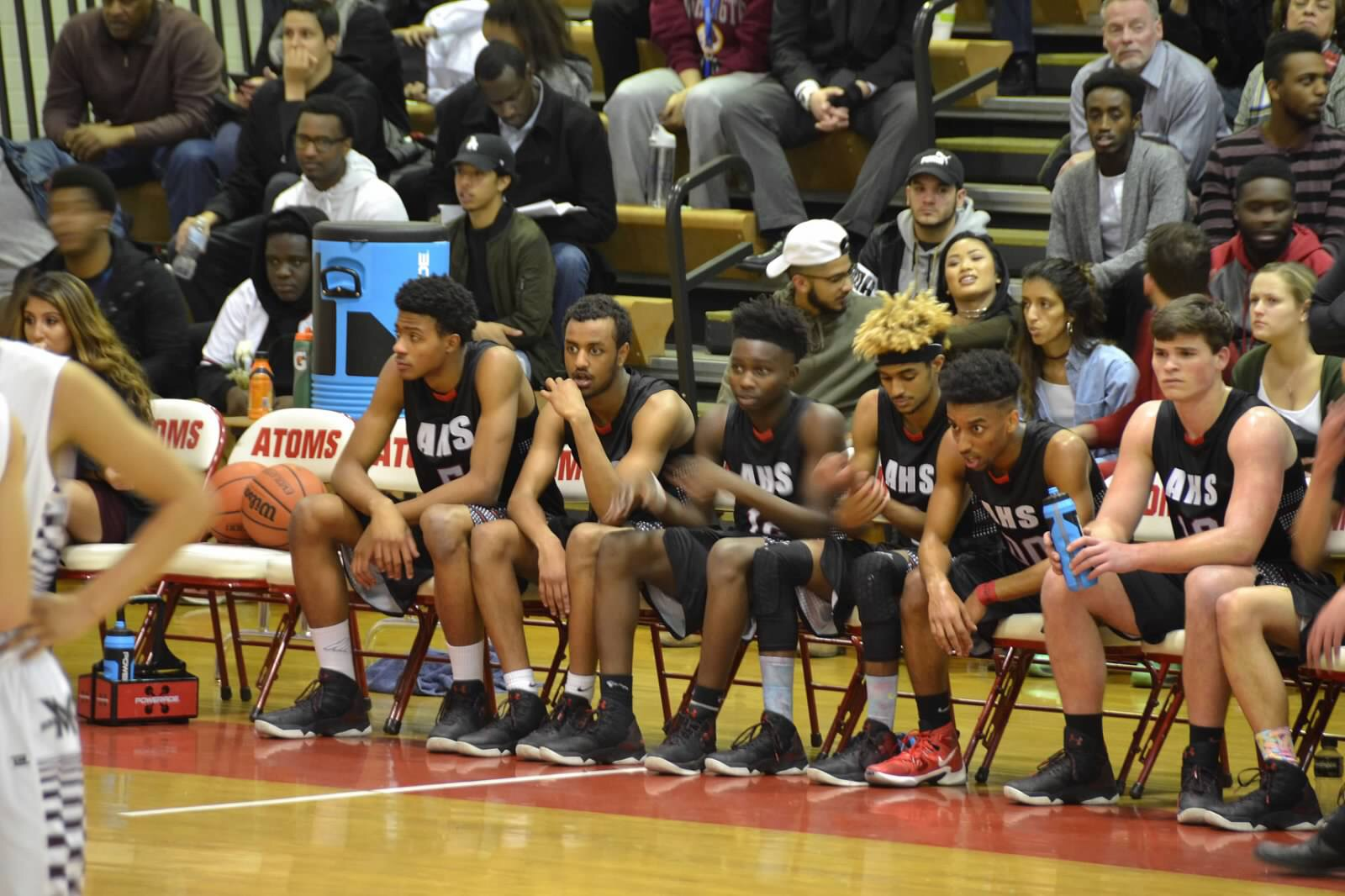 The Atoms' bench looks on during the game against Mount Vernon on Feb. 10.