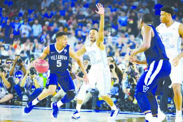 Junior%2C+Phil+Booth%2C+drives+the+lane+against+a+North+Carolina+defender+in+last+year%27s+NCAA+championship+game+where+Villinova+won+on+a+last+second+three+pointer+to+win+the+game+77-74