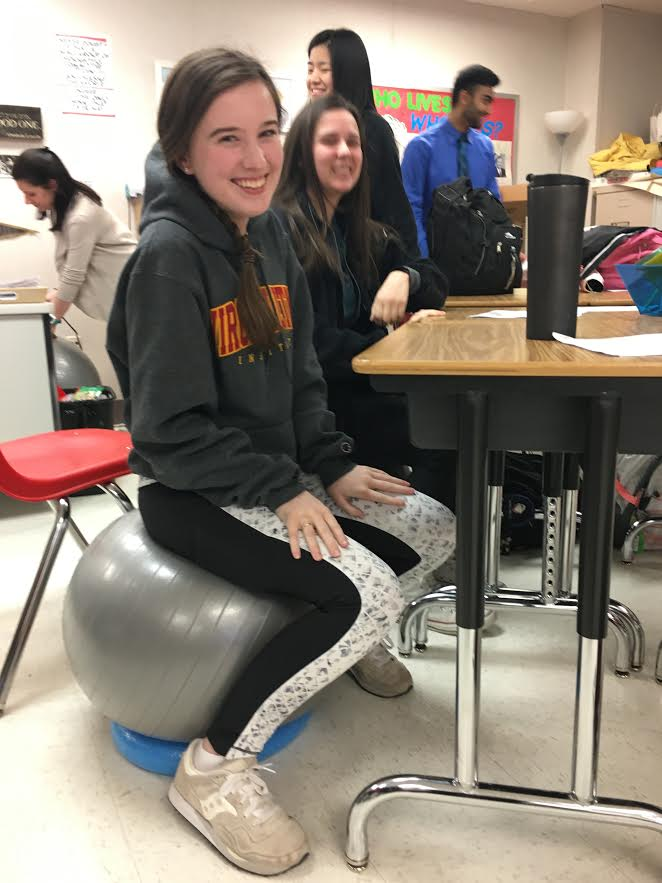 Senior+Madison+Schinstock+tests+out+the+new+yoga+balls+in+her+class.