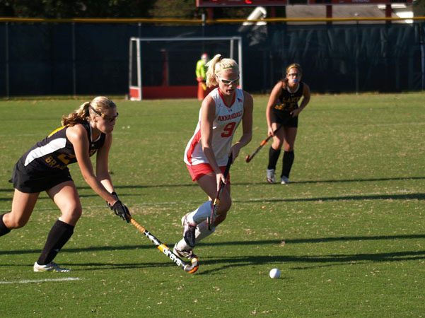 Junior Stephanie Allshouse protects the ball from an opposing Bruins player. The field hockey team will take on Lake Braddock again tonight in the first round of districts.