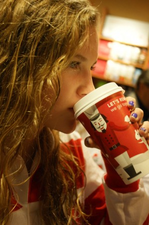 Sophomore Lizzie Manthos drinks a Starubucks seasonal beverage. Many students are unaware of the drink's lack of nutritional value.