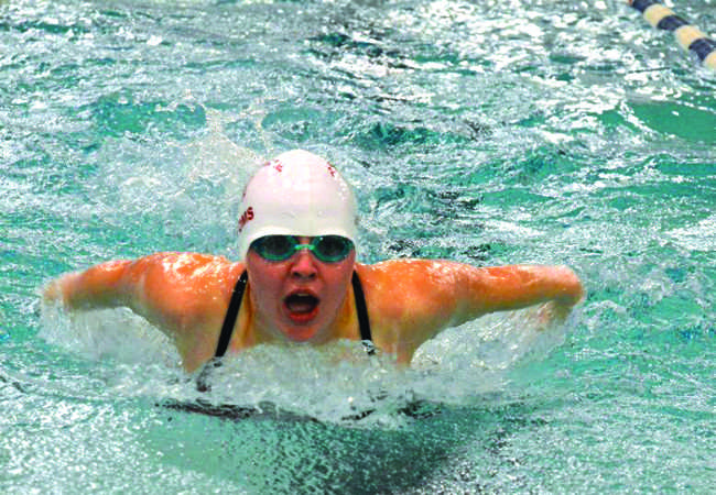 Junior Alexis Garretson competes in the 200-yard IM against West Potomac. The girls team fell to the Wolverines despite an improved performance from the previous year.