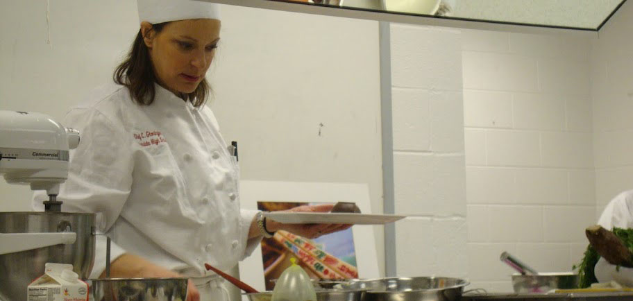 Chef Gloninger gives students a quick preview of a typical gourmet foods class during the Elective Fair.