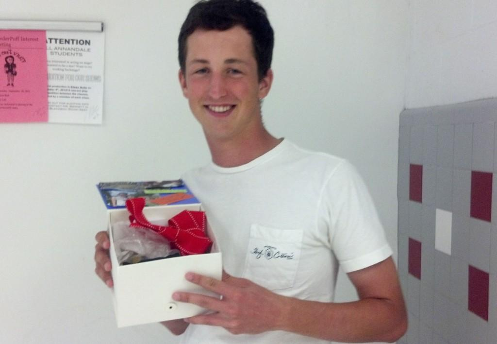 Senior Stephen Oakes holds the box that his girlfriend used to ask him to Homecoming. His girlfriend goes to Marshall HS and had another student bring the box to Oakes's R1 where the box would greet him at the start of class. Inside, the couple's inside jokes would be written alongside pictures and candy.