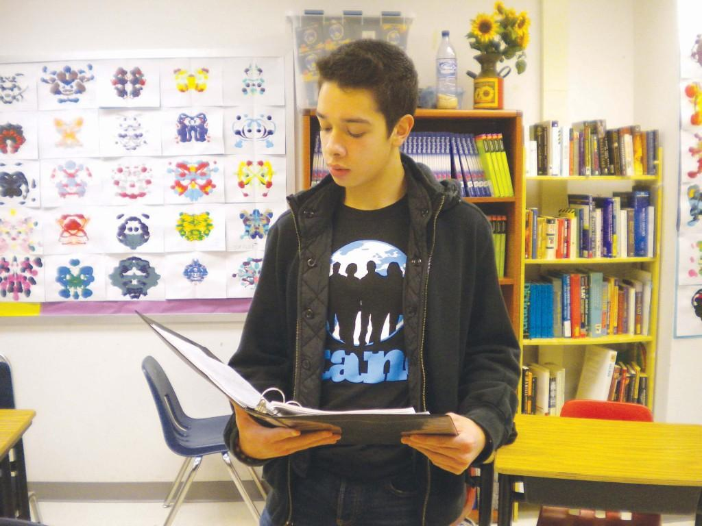 Senior Daniel Critchfield, co-president of STAND (the Student Anti-Genocide Coalition) speaks at the STAND interest meeting in Sept. 17 after school in Katie Gould's room.