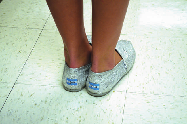 AHS student models her TOMS, which donates a pair of shoes to a child in need for every pair purchased