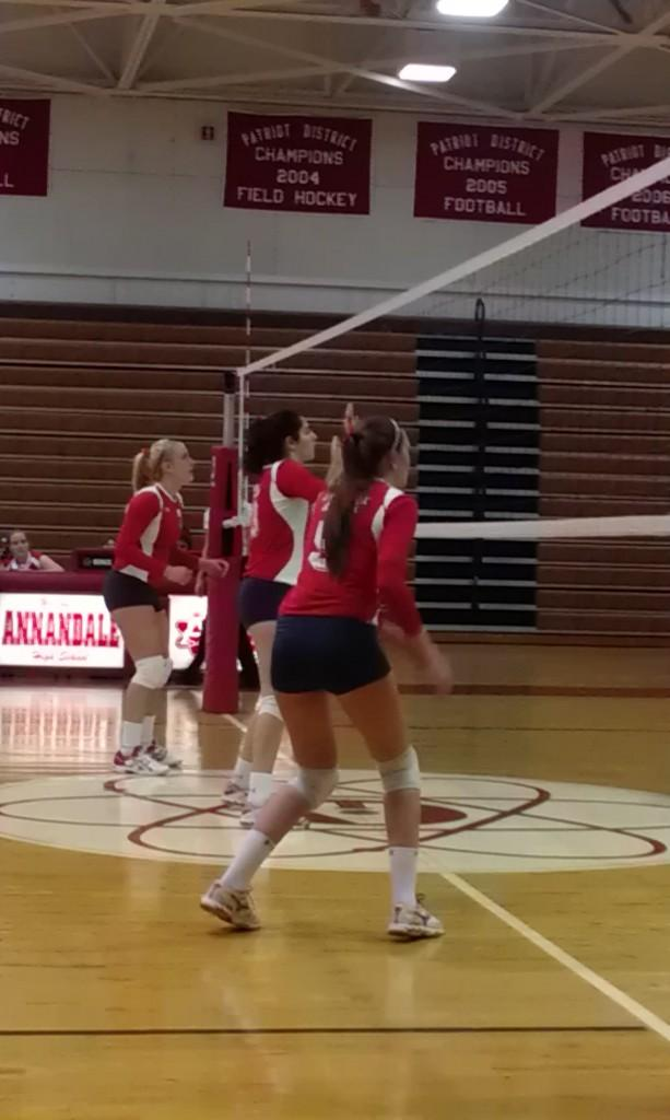Three+members+of+the+Varsity+volleyball+team+prepare+to+return+a+serve+from+South+Lakes+HS+players.