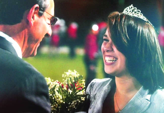 Principal Vincent Randazzo crowns last year's Homecoming Queen, Cynthia Quintanilla, at last year's Homecoming Game.