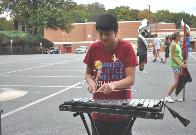 Freshman Jacob Nguyen practices his xylophone during rehearsal.