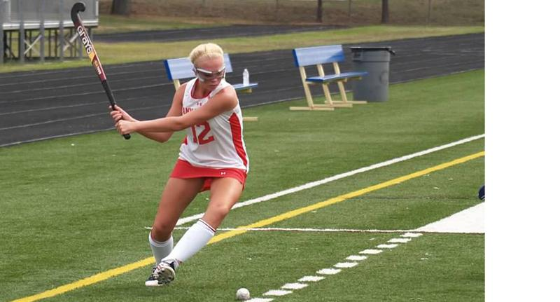 Sophomore Rachael Allshouse aims to cross the ball to her teammates inside the circle.