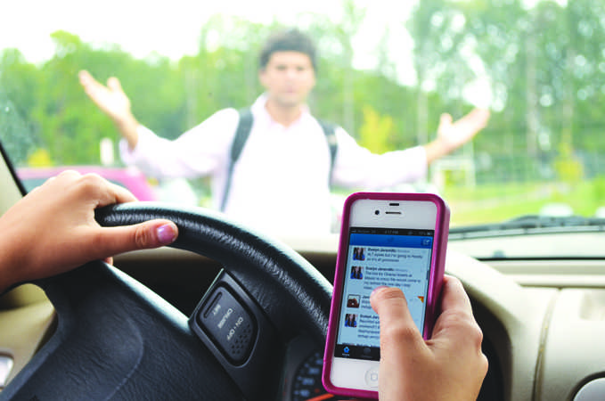 From texting, Instagram and Twitter to maps and IPhone apps, students are constantly checking their phones while driving.