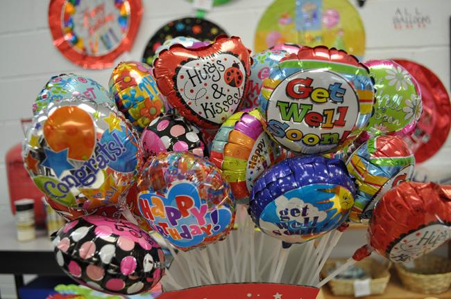The WAT store sells balloons for students to buy and pick up after school.