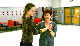English teachers Meg Jarrell and Marguerite Edwards practice the Canadian Barn dance.
