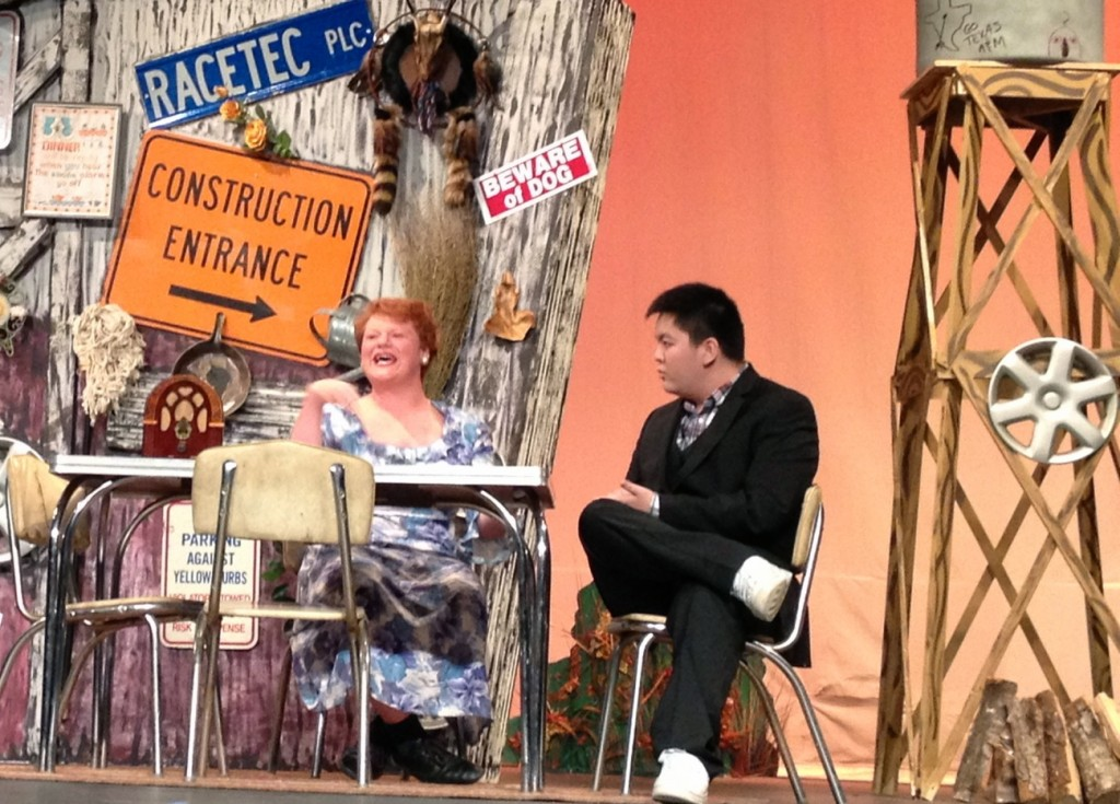 Senior Andrew Riddle plays Bertha Bumiller while senior Kevin Tran plays an eager interviewer in the show.