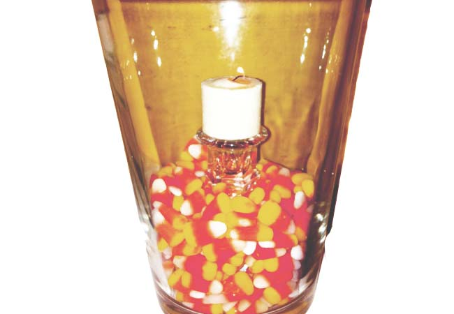 Hurricane candle is one of those quick and easy tips to get rid of unwanted Halloween leftover candy.