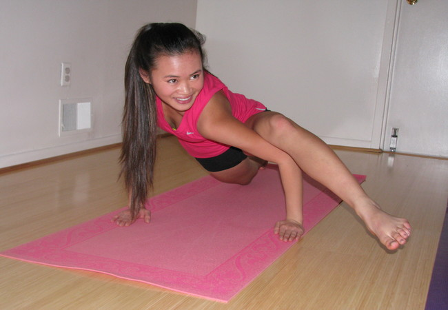 Junior Jennifer Nguyen twists her body before positioning herself into the Lizard Lunge, a popular step in yoga