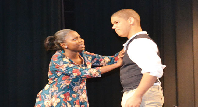 ESOL students Ramatu Fofanah and Hendell Concepcion played the mother of the bridegroom and the bridegroom. They performed one of several intense scenes from