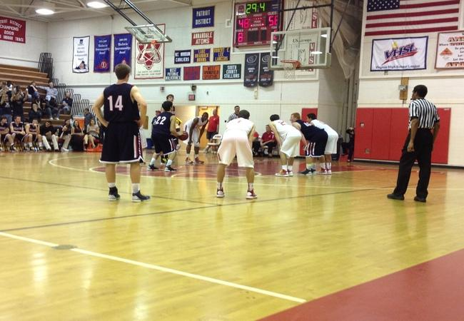 Everyone watches as a Woodson player takes his foul shots