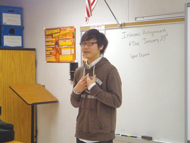 Senior Brian Quang performs an impromptu speech about the value of Starbucks.