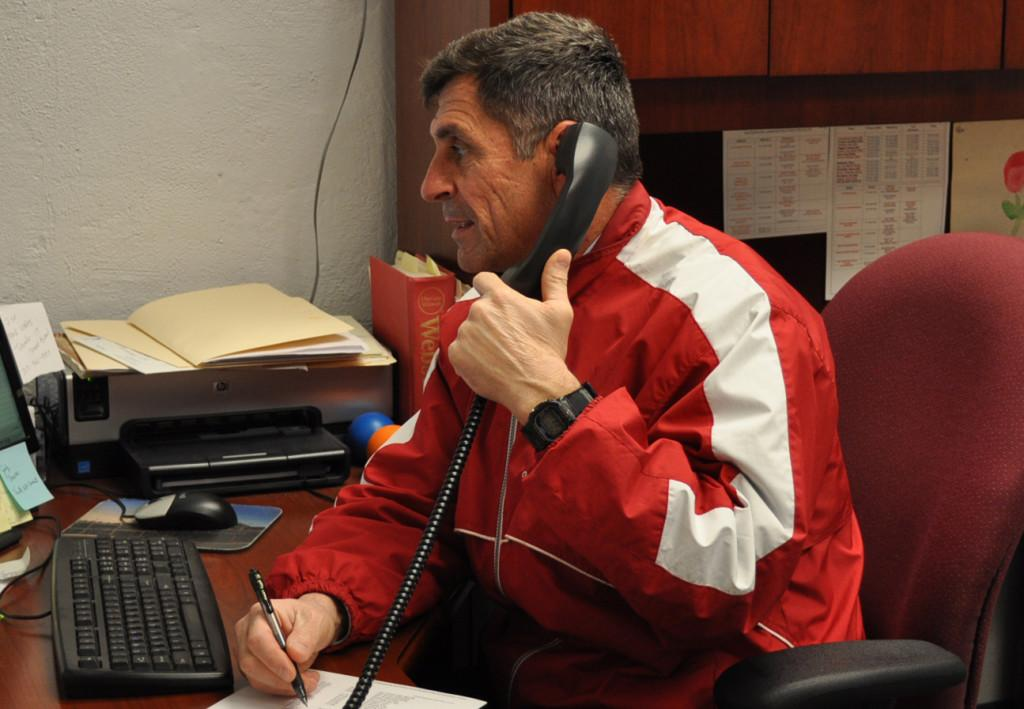 Assistant principal Jamie Carayiannis works in his office after school.
