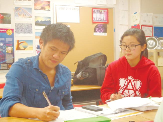 Senior Hung Truong, president of SNHS, and junior Ahyeong Park, vice president, talk about Pennies for Patients.