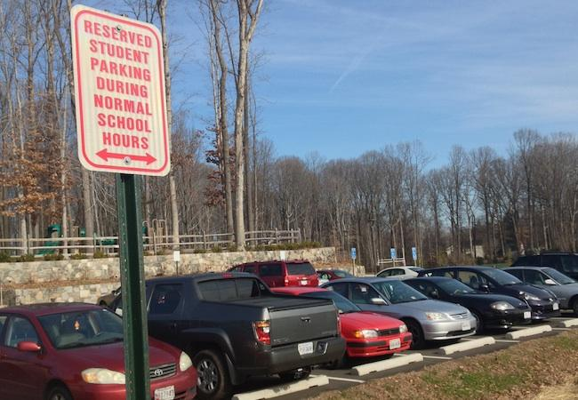 Students may no longer park at Ossian Hall Park without a parking pass, even in free spaces not owned by the school.