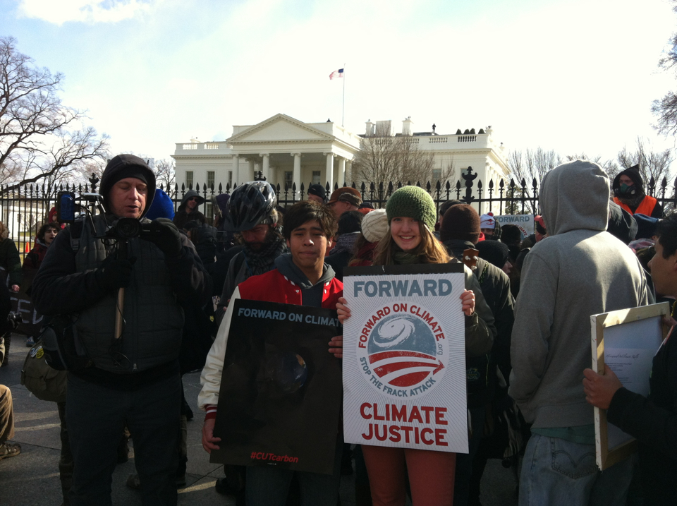 Junior J.C. Clark and sophomore Sarah Metzel hold protest signs in front of the White House as they exercise their constitutional right to freedom of assembly.