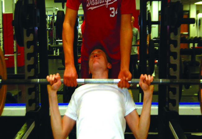 Freshman Grant Thompson lifts weights at one of the baseball green days.