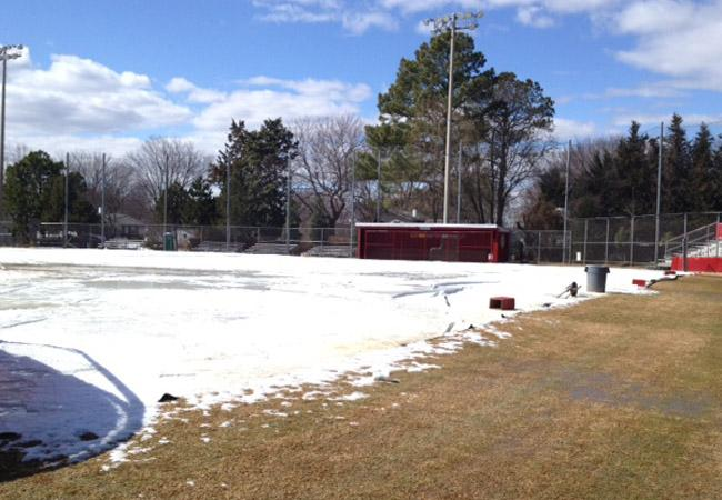 The baseball field was still partially covered in snow during school on March 7.