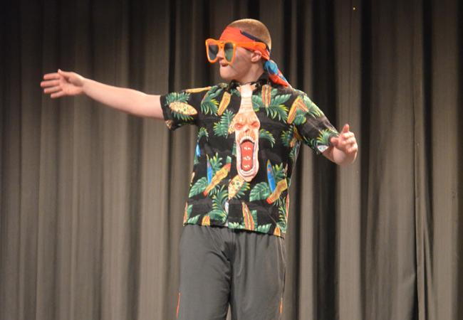 Senior Joey Rainey dressed in a wacky outfit during the Date for a Cure Auction. Date for a Cure raised the most money for the fundraiser.