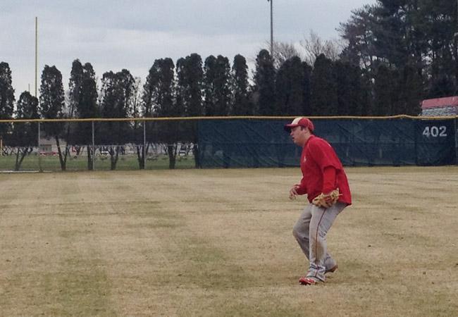 Senior Luke Lundy prepares to catch a fly ball.