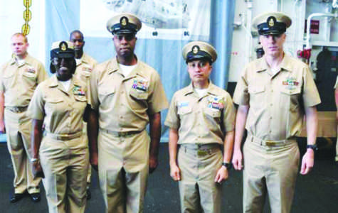 Pierce's dad (second from left) stands in uniform with his peers