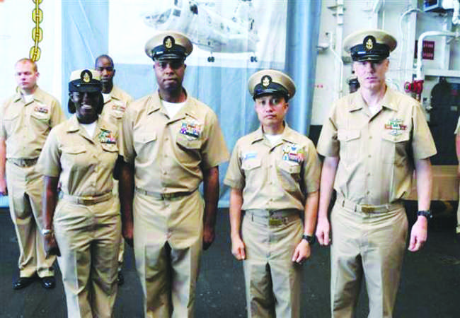 Pierces dad (second from left) stands in uniform with his peers