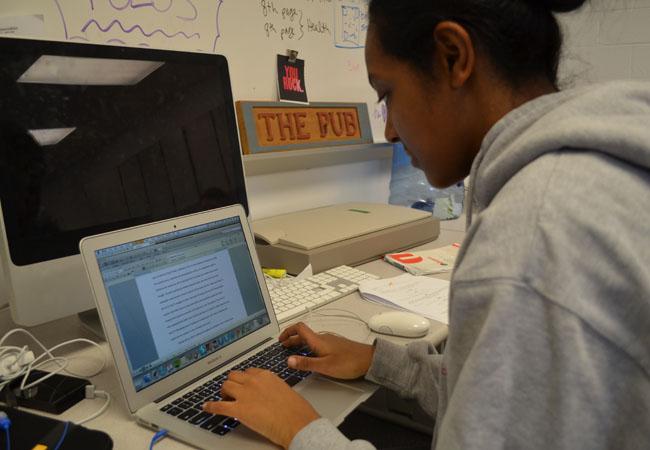 Senior Nardos Assefa spent multiple hours completing her Extended Essay.