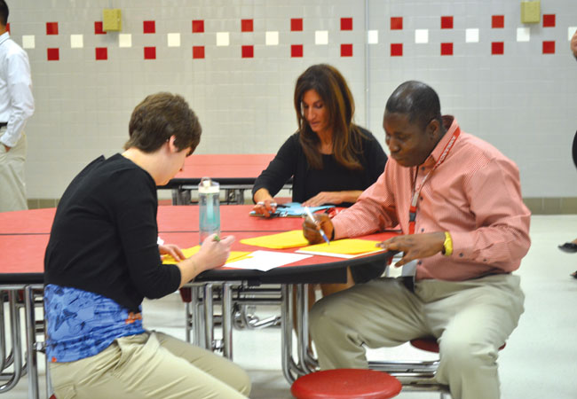 Science teachers Elizabeth Tuffs, Rachel Lazar and Issac Boakye grade the projects after all of the presentations.