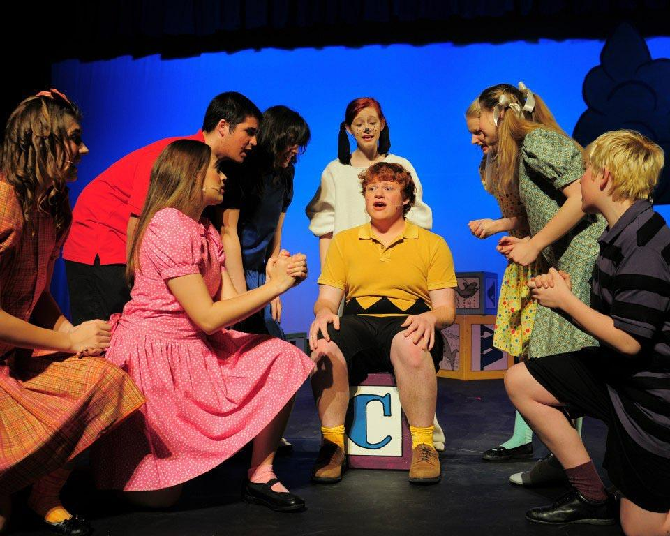 The cast of You're a Good Man, Charlie Brown preforms the opening act.