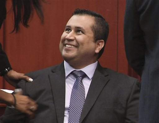George Zimmerman smiles after hearing the