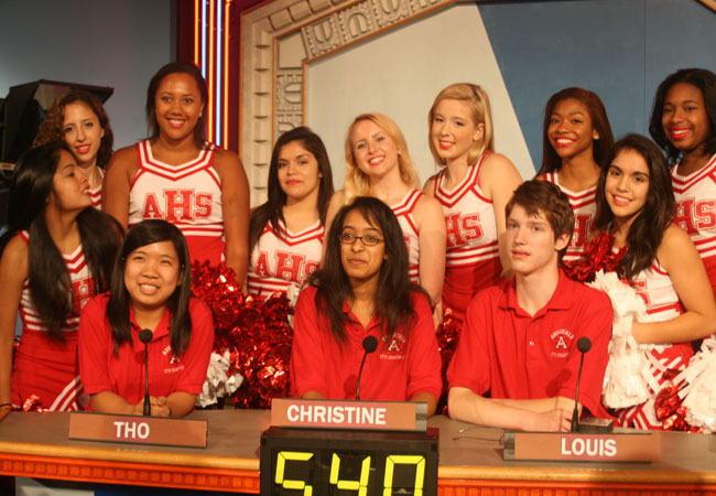The It's Academic team, starting from left, Tho Tranh, Christine Tamir and Louis Koch pose with the AHS Varsity cheer squad after their substantial win.