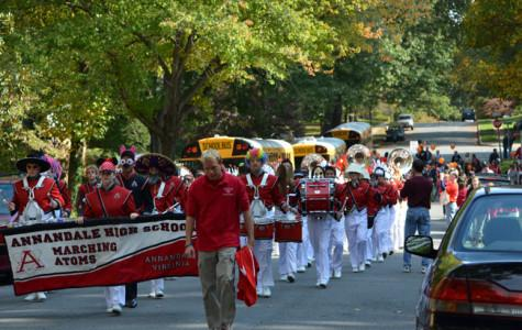 To follow tradition, the clarinet section of the Marching Atoms coordinate heir costumes at the Wakefield Chapel parade.