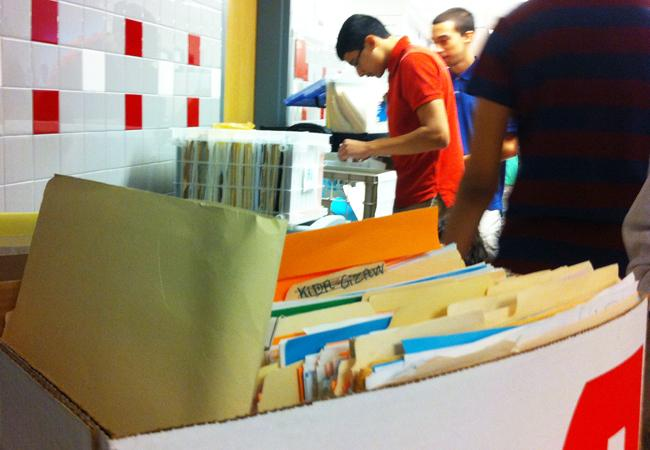 Students picked up their writing folders outside of the Publications Lab.