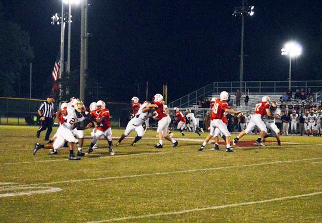 Senior quarterback Steven Schwartz prepares to make a pass during the game against Oakton HS.