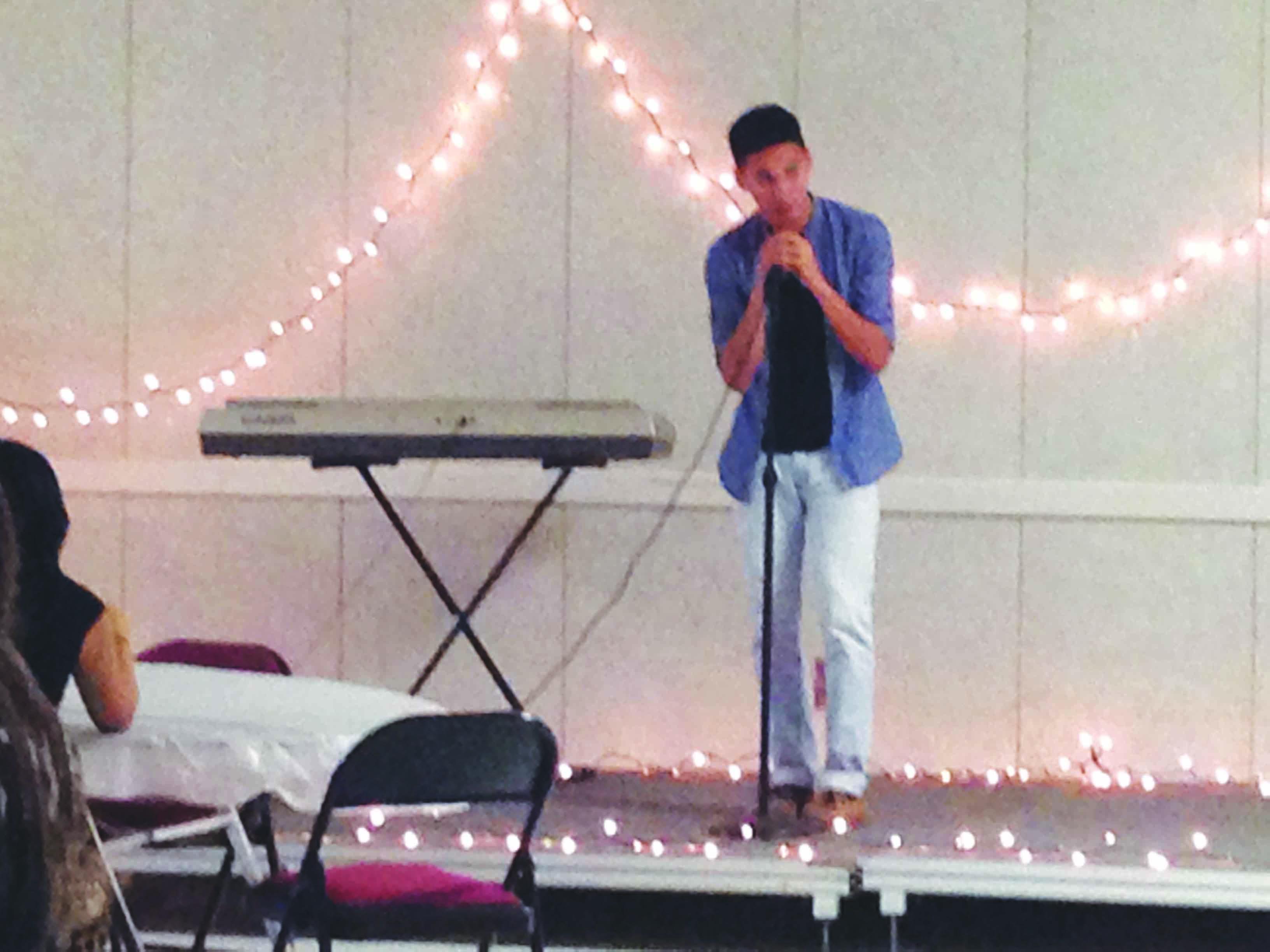 Students like junior Milton Garcia preformed their original music at the Coffeehouse.