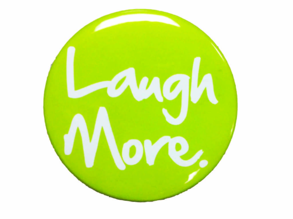 Laugh More buttons are being distributed during lunches all week.