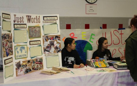Senior Kristina Nguyen and junior Soriya De Lopez present information about the Just World Interact Club at last year's festival.