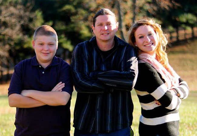 Gammon poses with her younger brother Ryan and her dad. She is the first in her immediate and extended family to attend college.