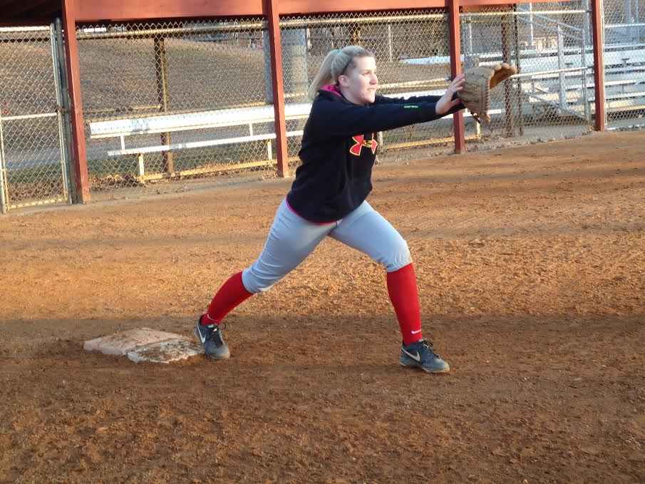 Senior first baseman Carly Potts prepares to catch a throw. The Varsity Softball team only had five outdoor practices before their first two games.