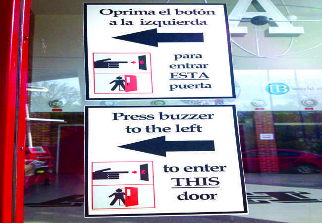 Signs have been posted around the school directing students to use the buzzers.