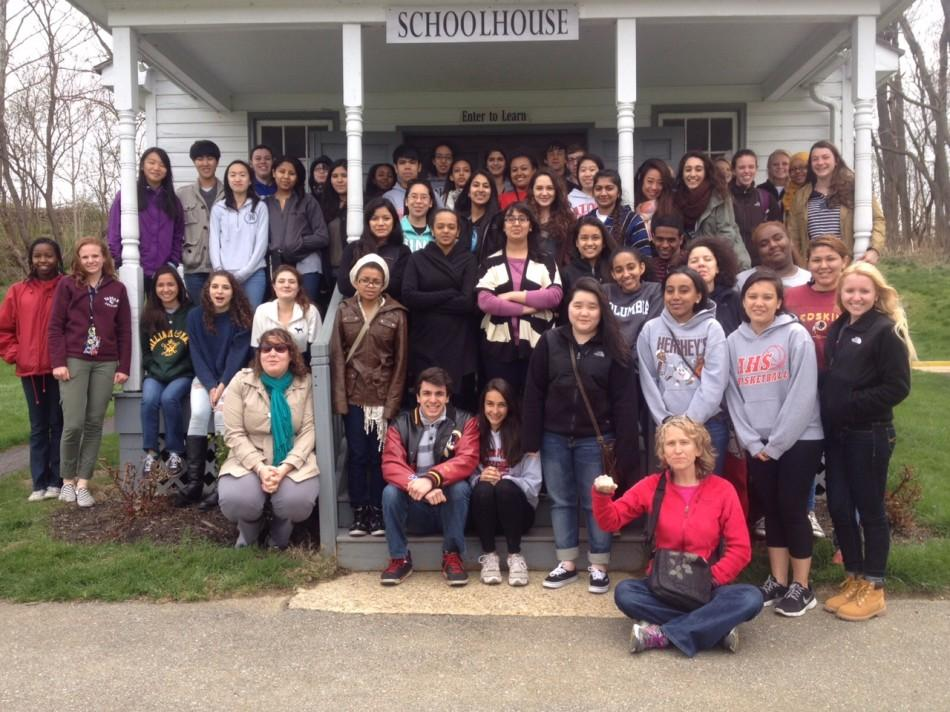 IB Anthropology students posing in front of a traditional Amish school