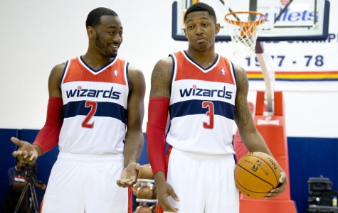 Beal and Wall talk during pre-game practice.
