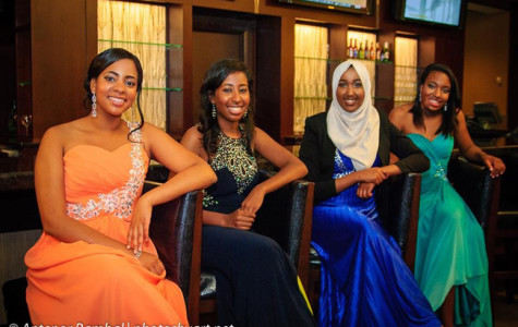 Seniors Melissa Stamp, Omnia Saed, Kothar Said and Jasmine Pringle pose for a photograph while at the dance.